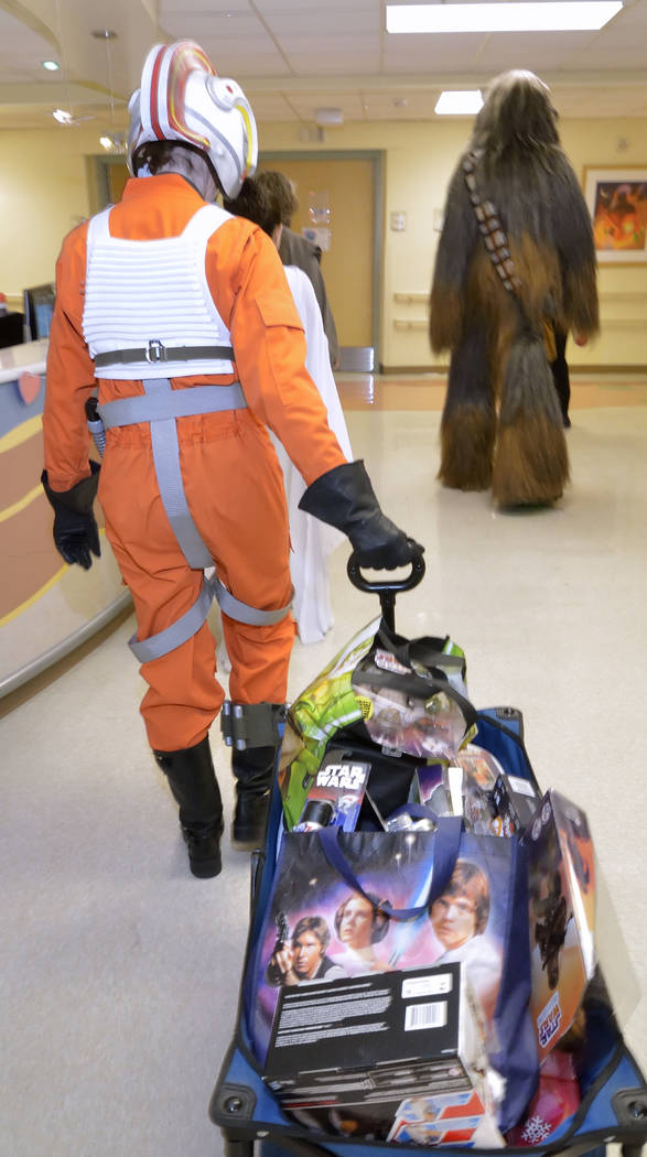 Tammy Simbal, left, is shown during a visit by members of the Rebel Legion Coruscant Base, a local chapter of an international Star Wars costuming organization, to Sunrise Children's Hospit ...
