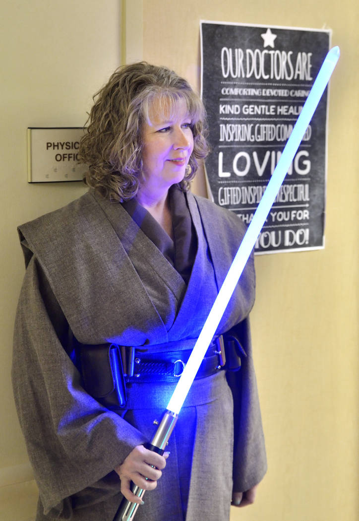 Rowena Hardin is shown during a visit by members of the Rebel Legion Coruscant Base, a local chapter of an international Star Wars costuming organization, to Sunrise Children's Hospital at ...