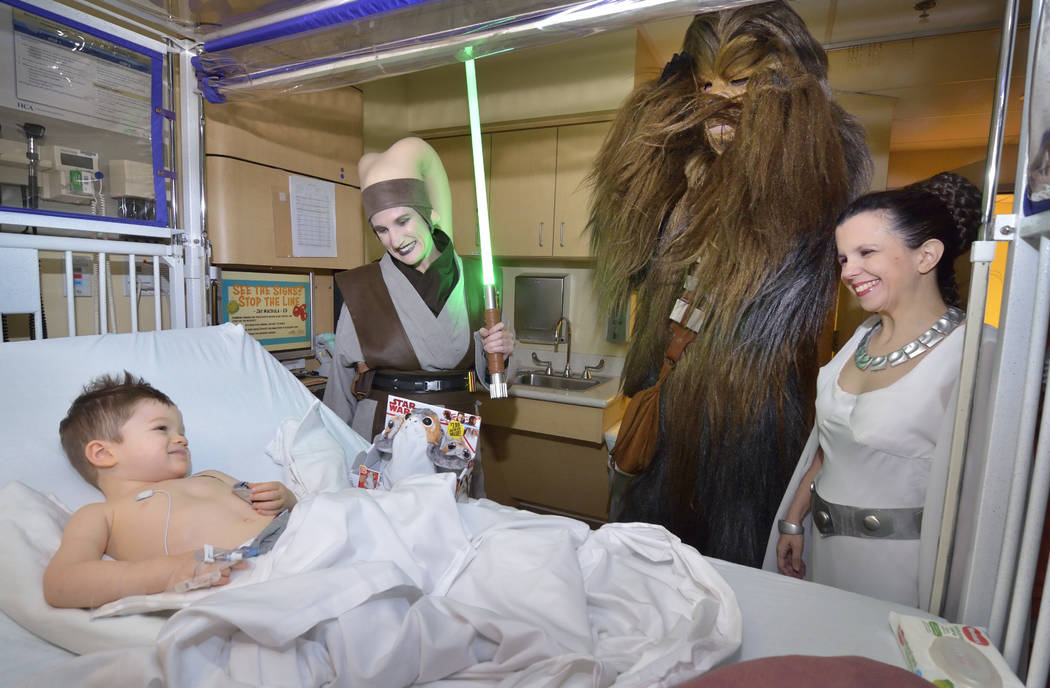 Finn Foust, 2, is visited by members of the Rebel Legion Coruscant Base, a local chapter of an international Star Wars costuming organization, at Sunrise Children's Hospital at 3186 S. Mary ...