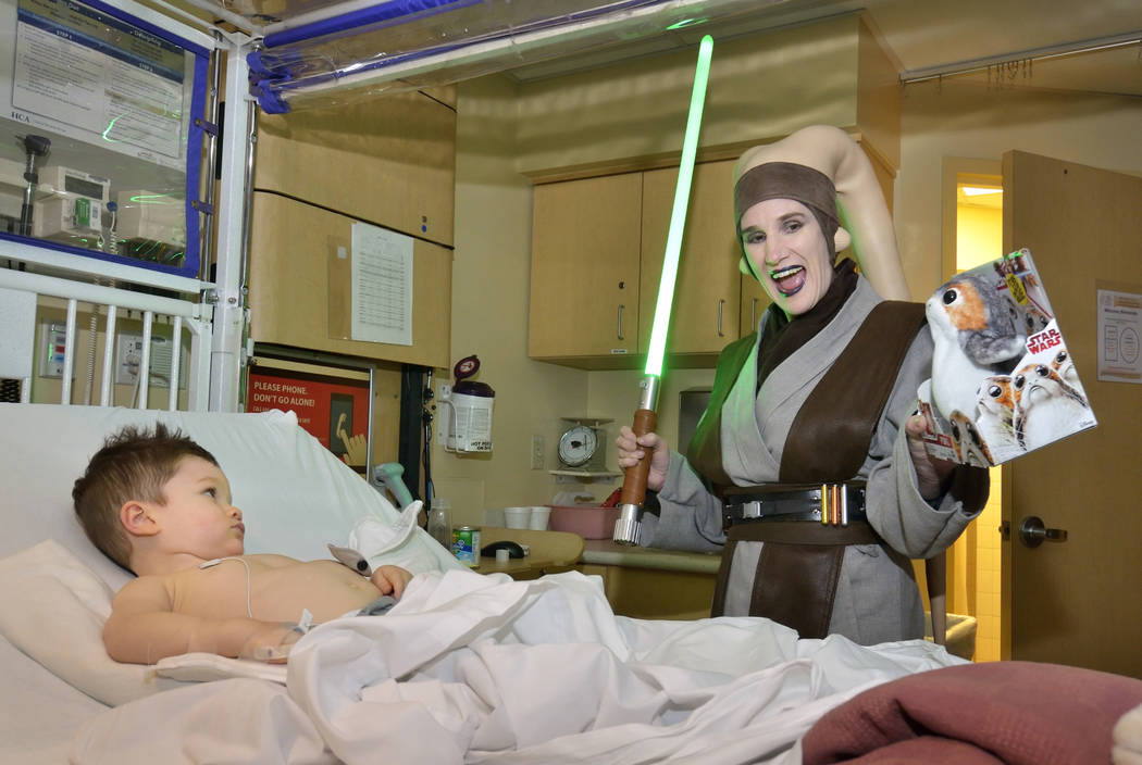 Finn Foust, 2, is visited by Mary Ann Nocie of the Rebel Legion Coruscant Base, a local chapter of an international Star Wars costuming organization, at Sunrise Children's Hospital at 3186 ...