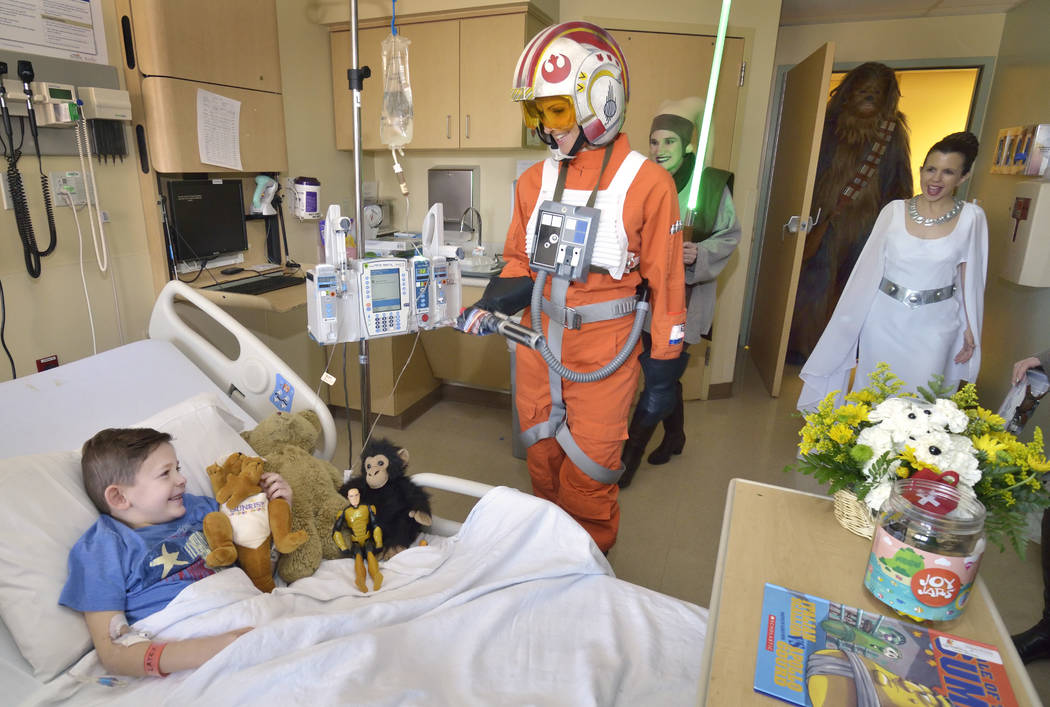 Santino Generelli, 5, is visited by members of the Rebel Legion Coruscant Base, a local chapter of an international Star Wars costuming organization, at Sunrise Children's Hospital at 3186 ...