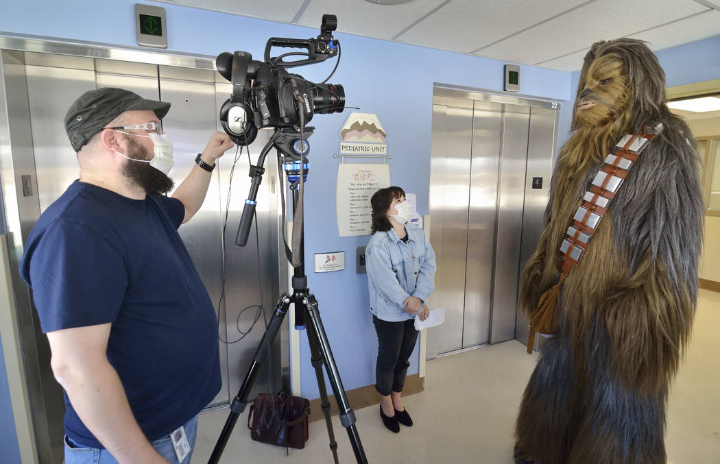 James Nocie, as Chewbacca, right, is shown during an interview with Review-Journal videographer Matthew Luschek, left, and reporter Rachel Spacek at Sunrise Children's Hospital at 3186 S. M ...