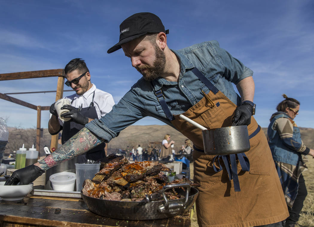 Momofuku's chef Shaun King, right, prepares lafah with slow-roasted short ribs during Whiskey in the Wilderness 2 on Sunday, January 14, 2018, at Spring Mountain Ranch State Park, in Las Vegas. Be ...