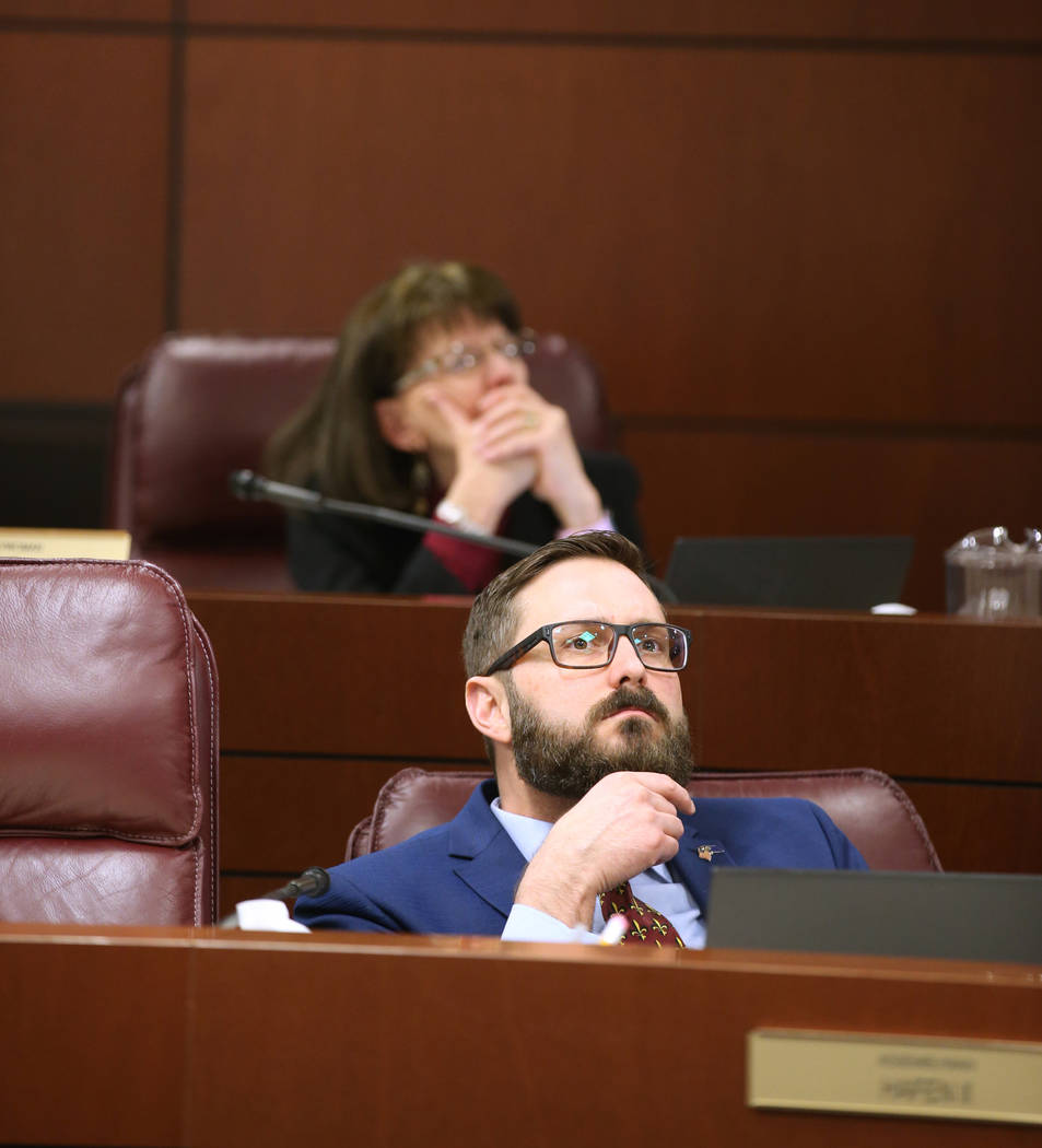 Assemblyman Gregory T. Hafen II, R-Pahrump, and Assemblywoman Robin L. Titus, R-Wellington, watch a presentation from Las Vegas Metropolitan Police Lt. Branden Clarkson and Clark County Deputy Fir ...