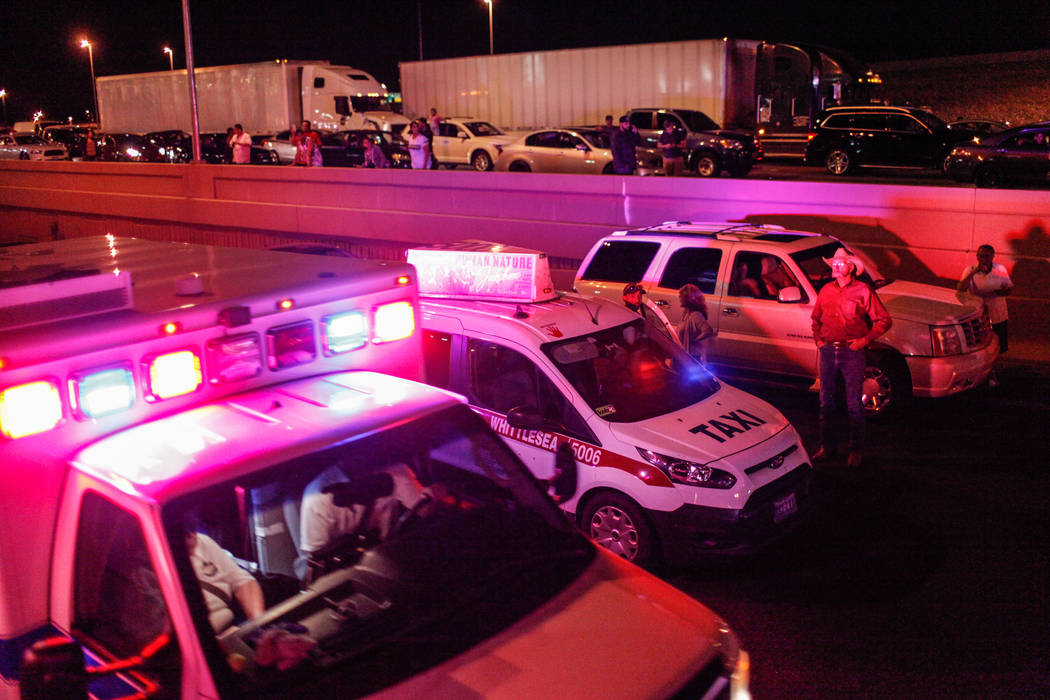 An ambulance drives past vehicles stopped on Interstate 15 in Las Vegas after a shooting on the Strip left 58 dead Sunday, Oct. 1, 2017. Joel Angel Juarez Las Vegas Review-Journal @jajuarezphoto