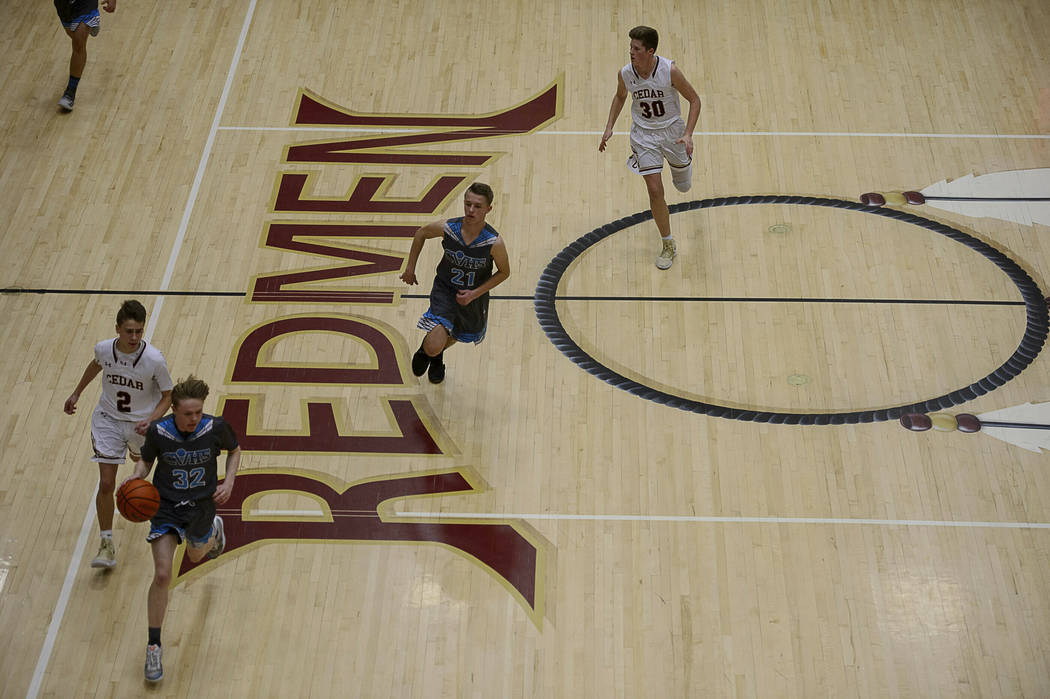 """This Jan. 11, 2019 photo shows a basketball game at Cedar High School in Cedar City, Utah. The southern Utah high school is getting rid of its """"Redmen"""" mascot as it becomes the lates ..."""