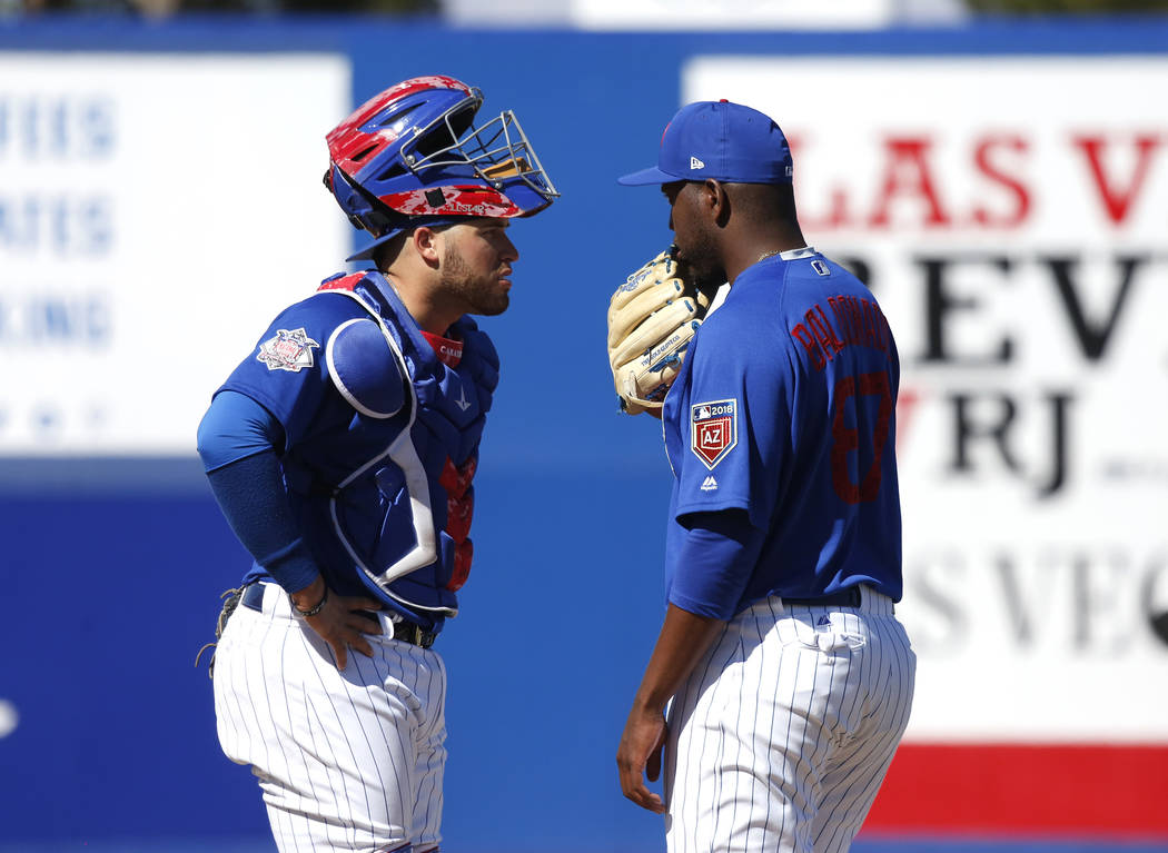 Chicago Cubs' Victor Caratini (7) and Alberto Maldonado (87) at the annual Big League Weekend baseball game against the Cleveland Indians at Cashman Field in Las Vegas on Sunday, March 18, 2018. A ...