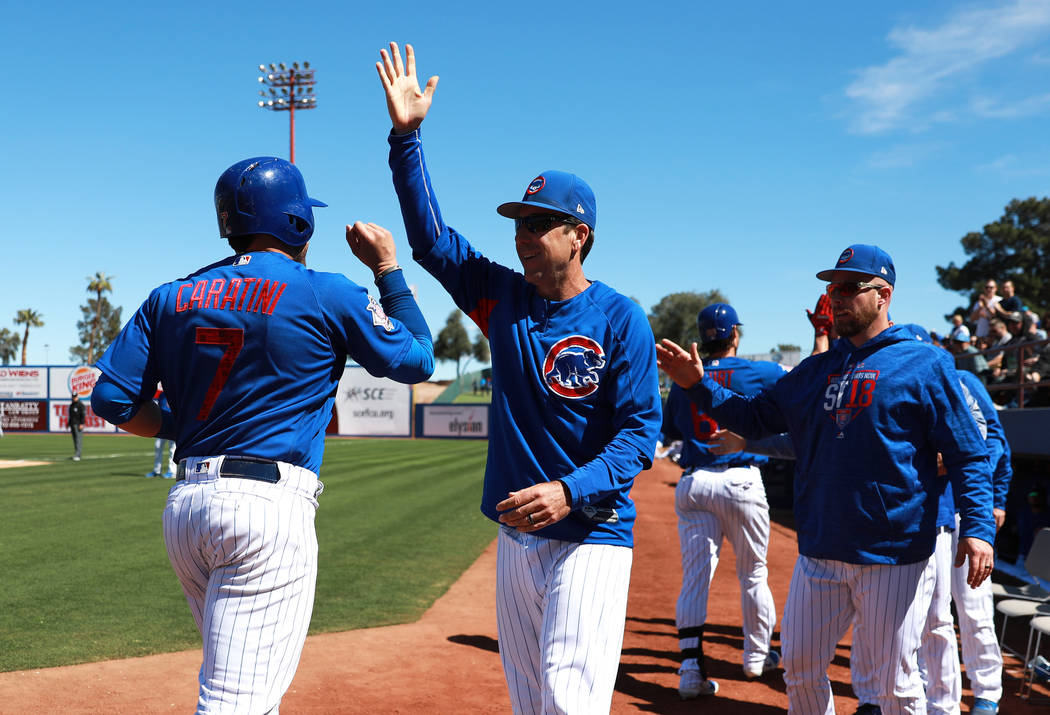 Chicago Cubs' Victor Caratini (7) cheers with his time at the annual Big League Weekend baseball game against the Cleveland Indians at Cashman Field in Las Vegas on Sunday, March 18, 2018. Andrea ...
