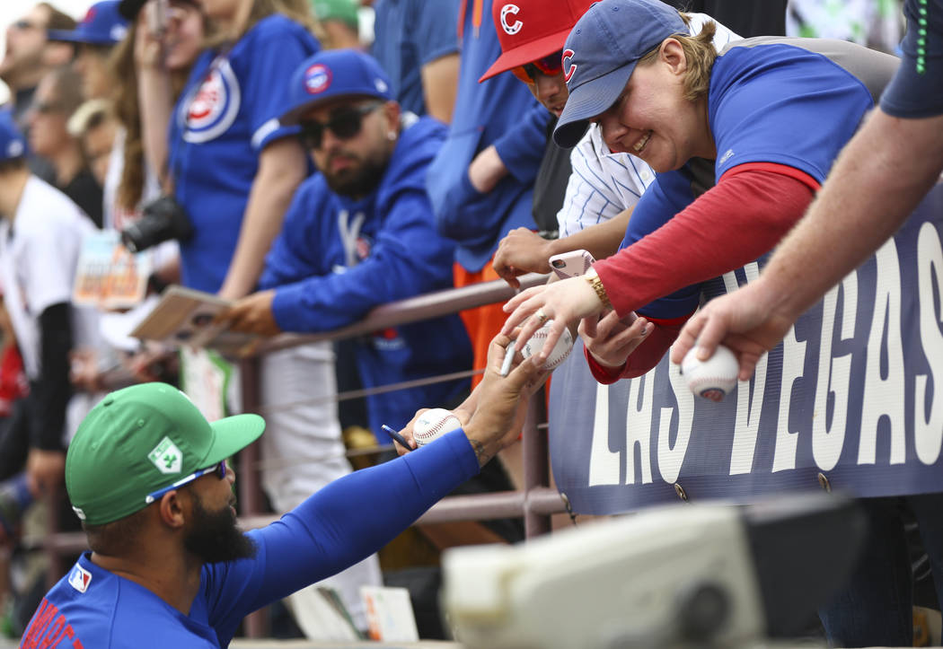Chicago Cubs starting pitcher Randy Rosario signs autographs for fans before the start of the annual Big League Weekend baseball game at Cashman Field in Las Vegas on Saturday, March 17, 2018. Cha ...
