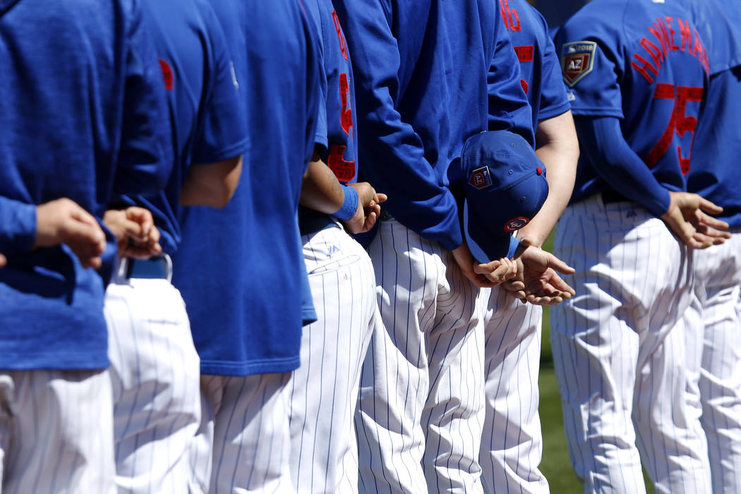The Chicago Cubs stand for the pledge of allegiance during the annual Big League Weekend baseball game at Cashman Field in Las Vegas on Sunday, March 18, 2018. Andrea Cornejo Las Vegas Review-Jour ...
