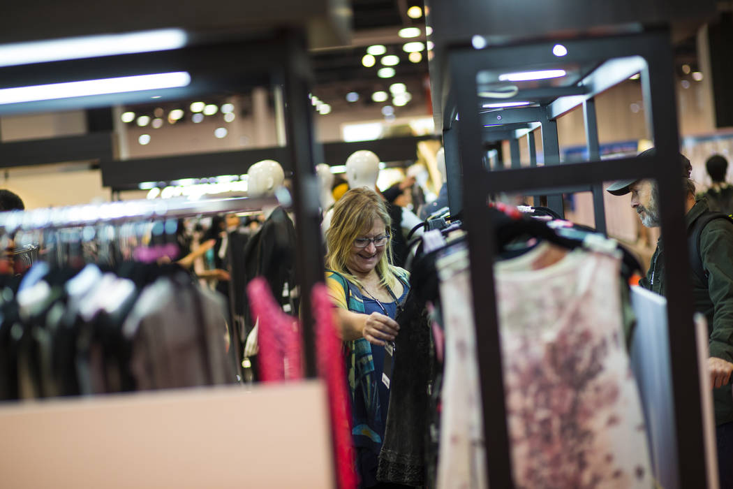 Cynthia Fisher of Washington looks at items from Vocal Apparel at the MAGIC trade show at the Las Vegas Convention Center in Las Vegas on Wednesday, Feb. 6, 2019. (Chase Stevens/Las Vegas Review-J ...