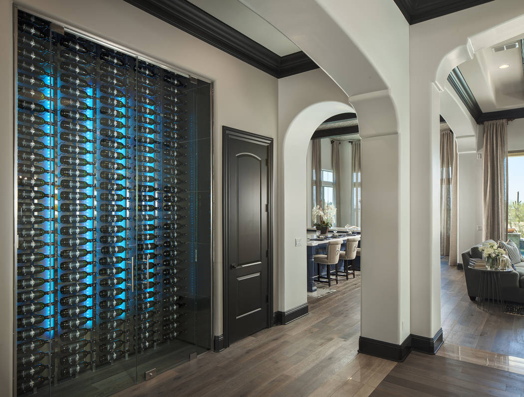 This contemporary lighted wine wall cellar by Innovative Wine Cellar Designs is dual-sided and can be seen from the hallway and the dining room. (Michael Baxter/Baxter Imaging LLC)