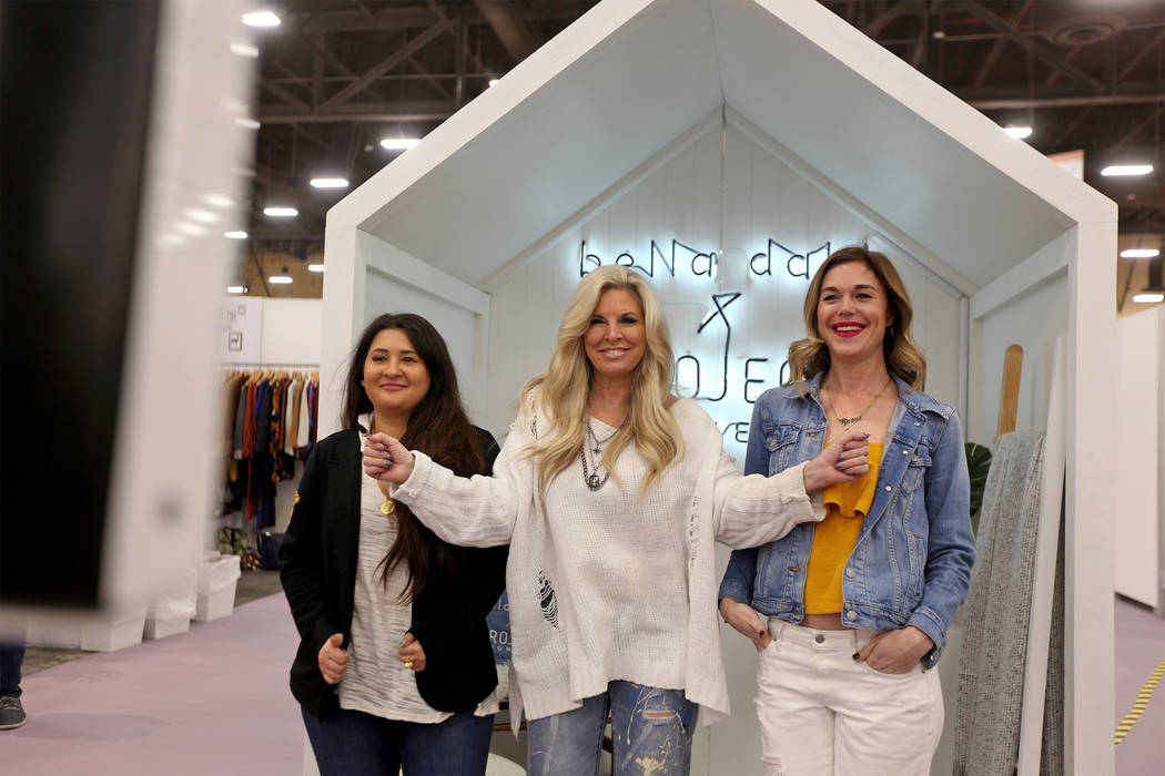 Hunter Brock, from left, Kimberly Waczak, and Sally January pose for a photo at a photo booth at the fashion trade show MAGIC at the Mandalay Bay Convention Center in Las Vegas, Wednesday, Feb. 6, ...