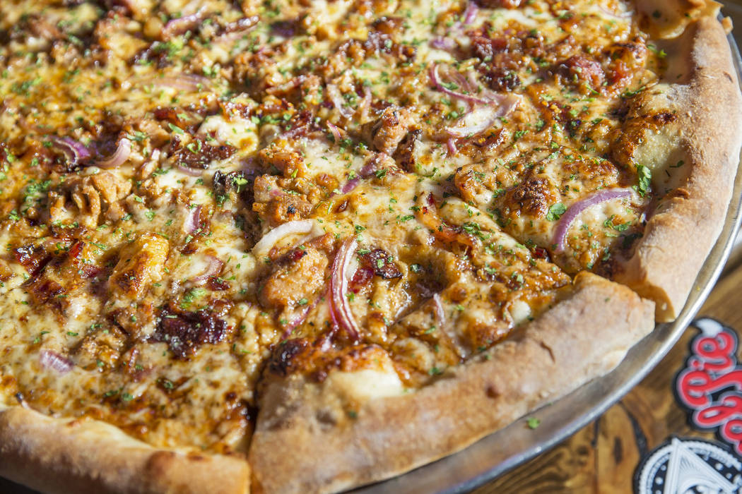 The Hog Heaven pizza, made with man candy bacon, pulled pork, red onions, parsley, smoked mozzarella and barbecue sauce. Photo taken on Saturday, Jan. 21, 2017, at Evel Pie, in Las Vegas. Benjamin ...