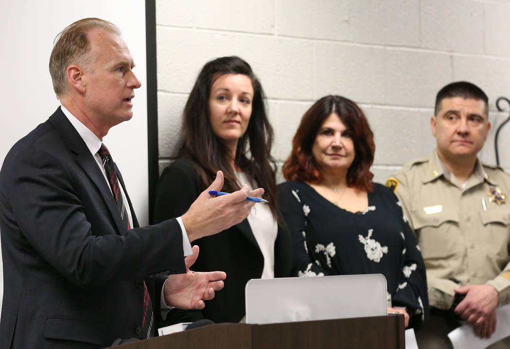 Jim Sweetin, left, chief deputy district attorney, announces the creation of the Southern Nevada Sex Trafficking Multidisciplinary Team during a press conference as Brittany Hopballe, second right ...