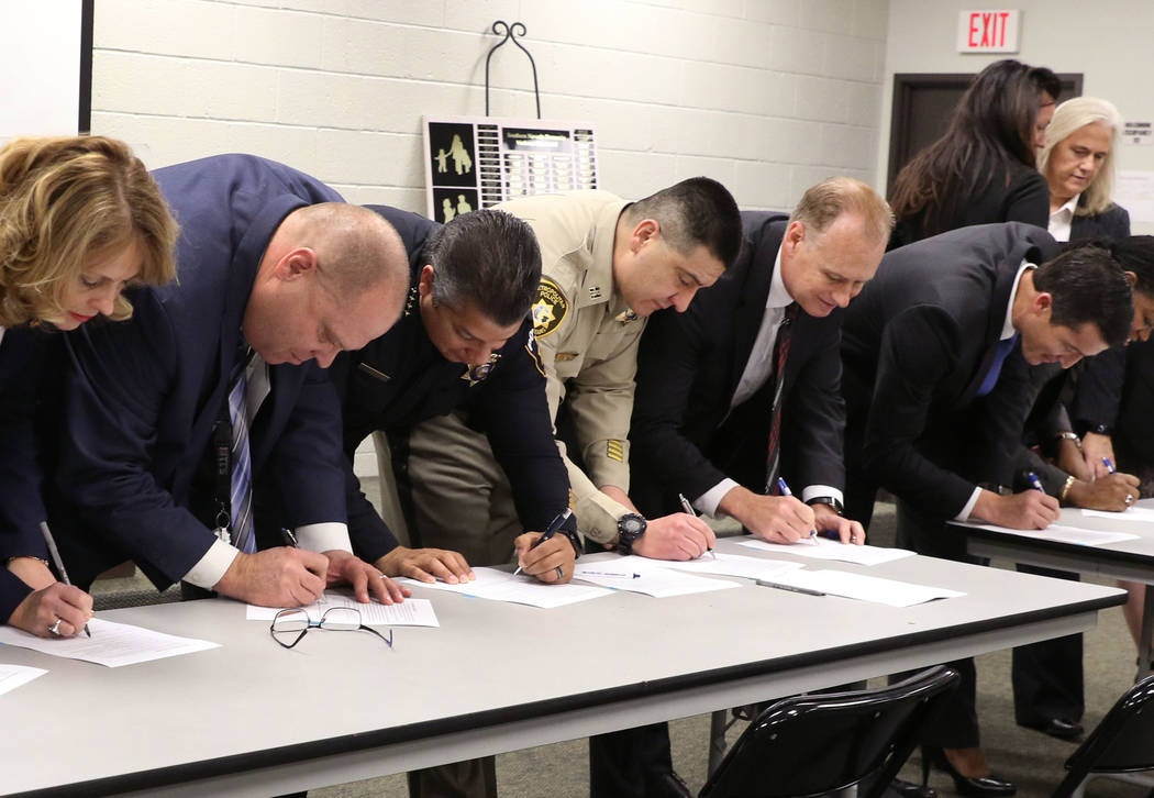 Agency representatives, including US attorney Nick Trutanich, far right, Jim Sweetin, chief deputy district attorney, second right, and Metropolitan Police Department Capt. John Leon, third right, ...
