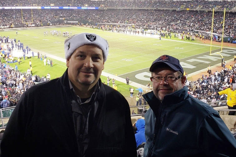 Dan Holmgren, left, and friend Rich Newmark are shown at Oakland Coliseum during the Raiders game against the Denver Broncos on Dec. 24, 2018. Holmgren was terminated as a Las Vegas limousine driv ...