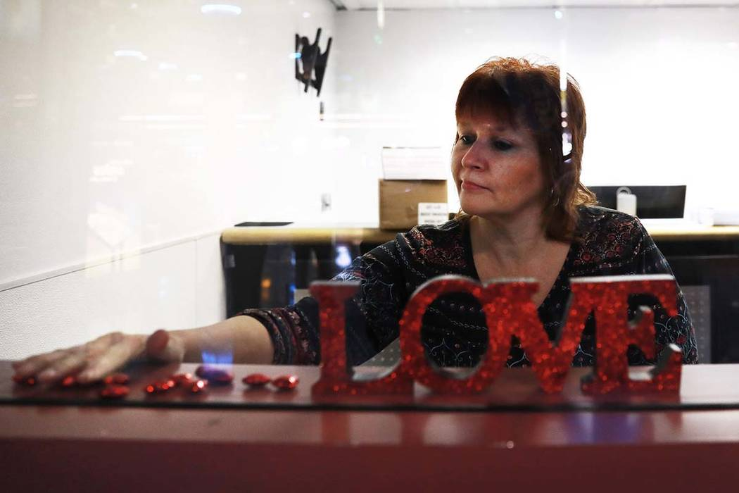 Paula Cooks, a supervisor, decorates a wedding license office at the McCarran International Airport in Las Vegas, Thursday, Feb. 8, 2018. The Clark County Clerk's Office will have the office ope ...