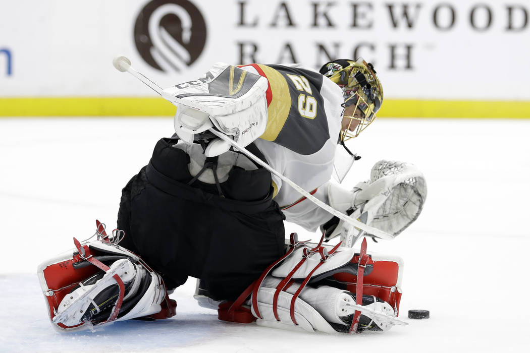 Vegas Golden Knights goaltender Marc-Andre Fleury makes a save on a shot by the Tampa Bay Lightning during the second period of an NHL hockey game Tuesday, Feb. 5, 2019, in Tampa, Fla. (AP Photo/C ...