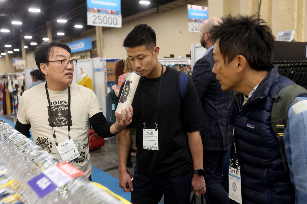 Eric Na at the Sand Stuff booth at the MAGIC fashion trade show at the Mandalay Bay Convention Center in Las Vegas, Wednesday, Feb. 6, 2019. Sand Stuff uses recycled coffee to make designs. (Rache ...