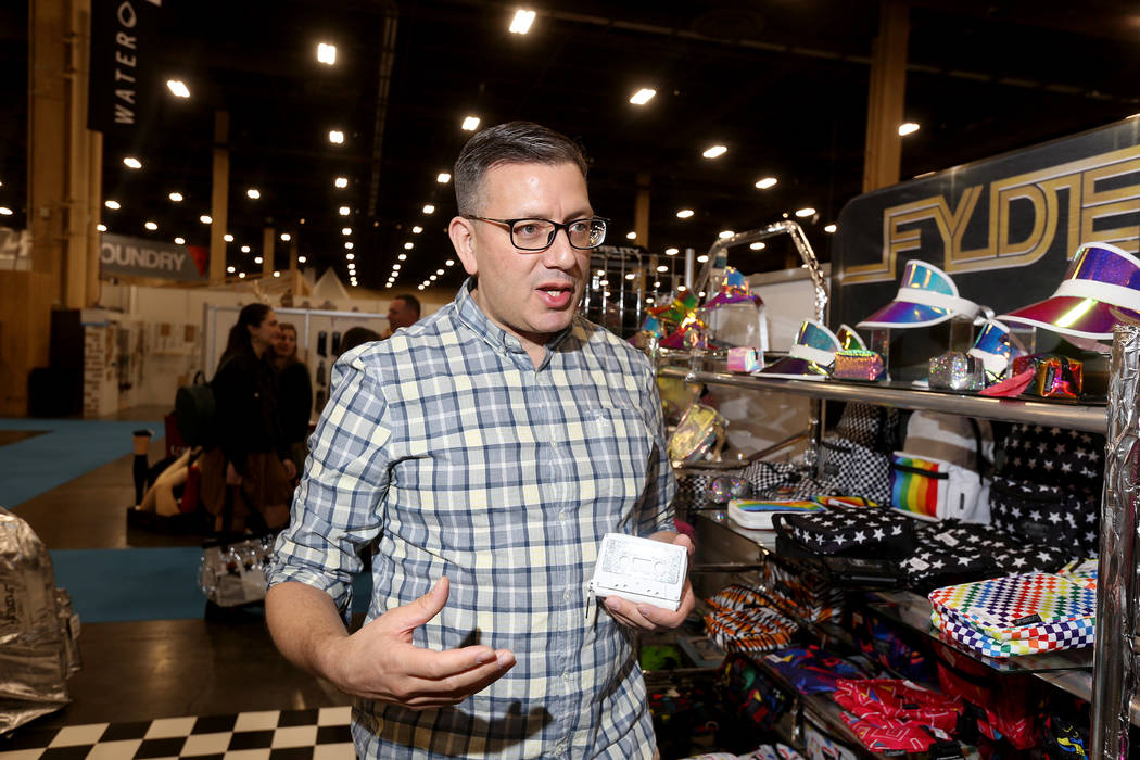 Jason Entner's company, Fidelity, creates retro cassette tape wallets. Fidelity has a booth at the MAGIC fashion trade show at the Mandalay Bay Convention Center in Las Vegas, Wednesday, Feb. 6, 2 ...