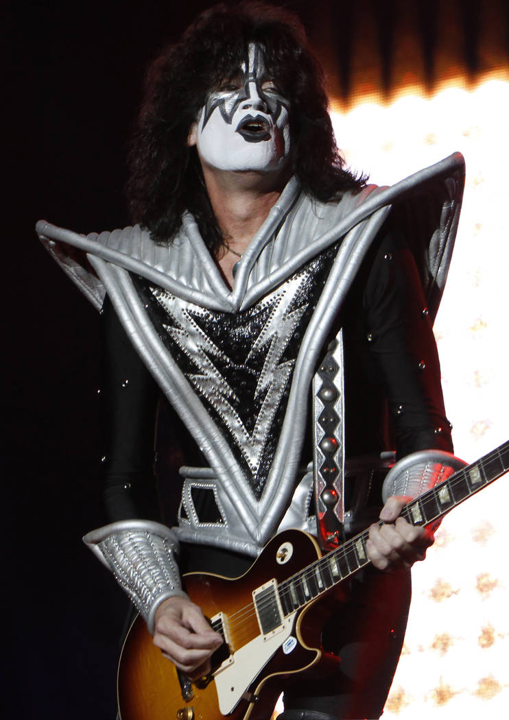Tommy Thayer of Kiss performs during a concert in Mexico City, Saturday, Sept. 29, 2012. (AP Photo/Marco Ugarte)