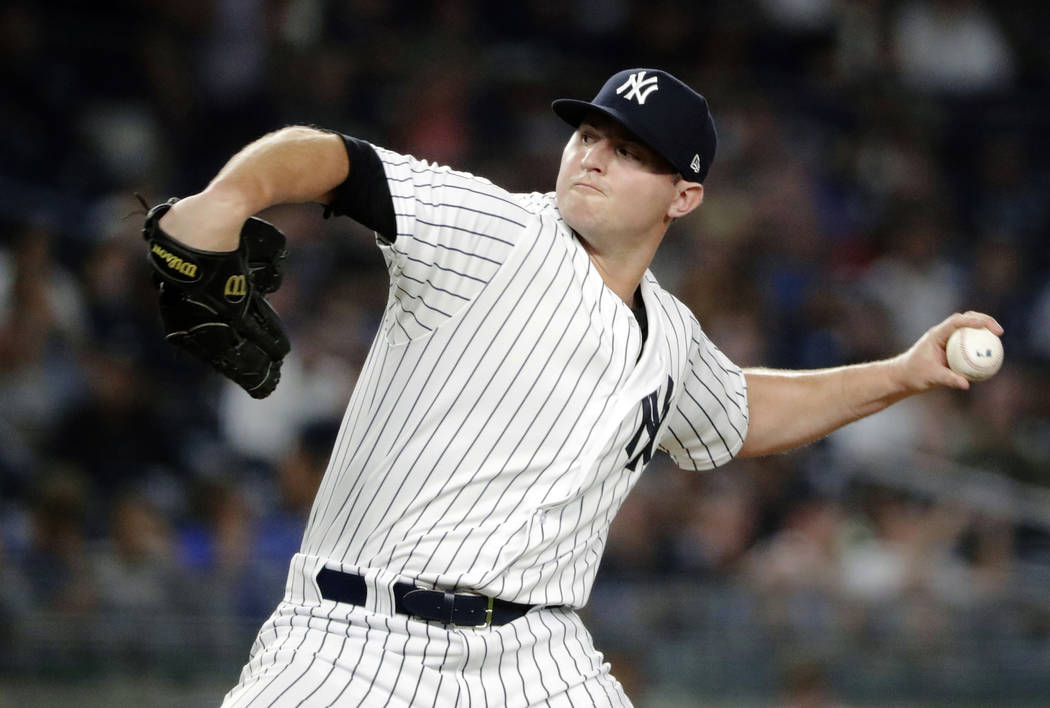 In this July 26, 2018, file photo, New York Yankees' Zach Britton delivers a pitch during the eighth inning of a baseball game against the Kansas City Royals, in New York. Known throughout his bas ...