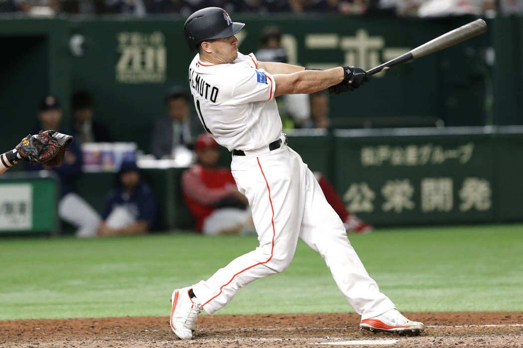 MLB All-Star catcher J.T. Realmuto of the Miami Marlins hits a three-run home-run off All Japan's pitcher Masaru Sato in the eighth inning of Game 2 of their All-Stars Series baseball at Tokyo Dom ...