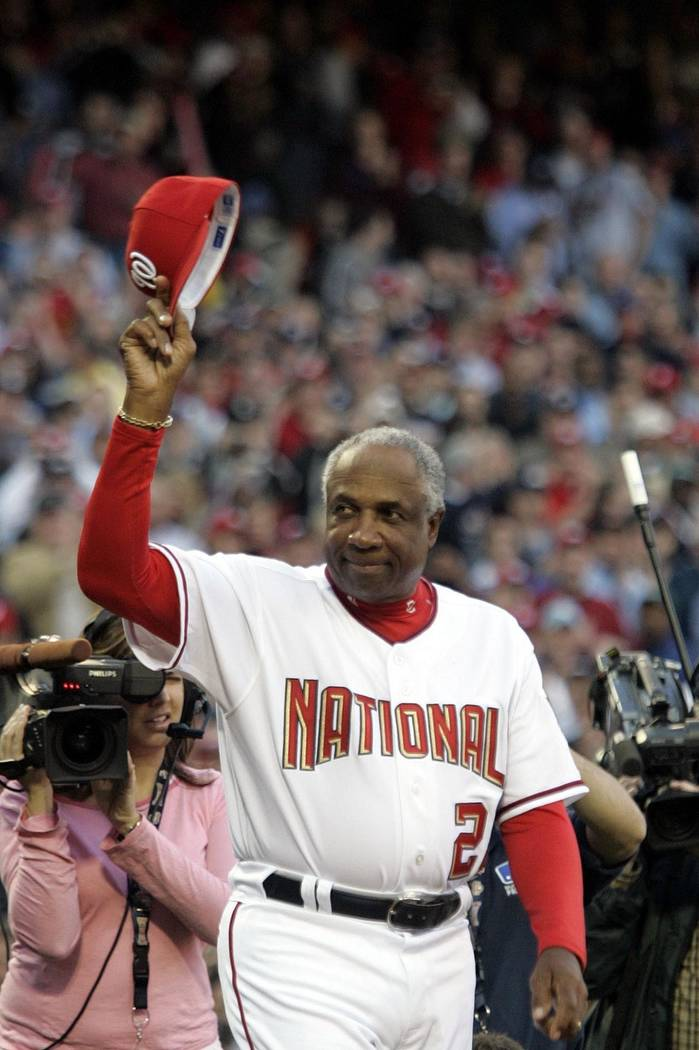 In this April 14, 2005, file photo, Washington Nationals manager Frank Robinson tips his hat to the crowd as he is introduced during their home opener against the Arizona Diamondbacks, at RFK Stad ...