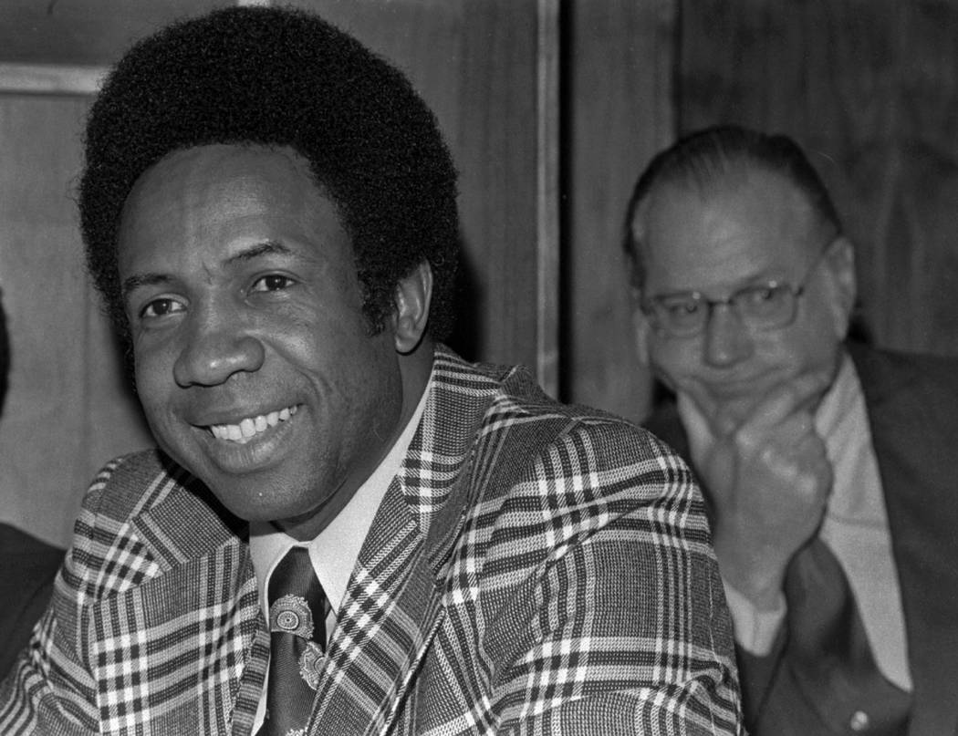 This June 19, 1996, file photo shows Frank Robinson at a news conference in Cleveland, Ohio, after being named Major League Baseball's first black manager, with the Cleveland Indians. In the backg ...