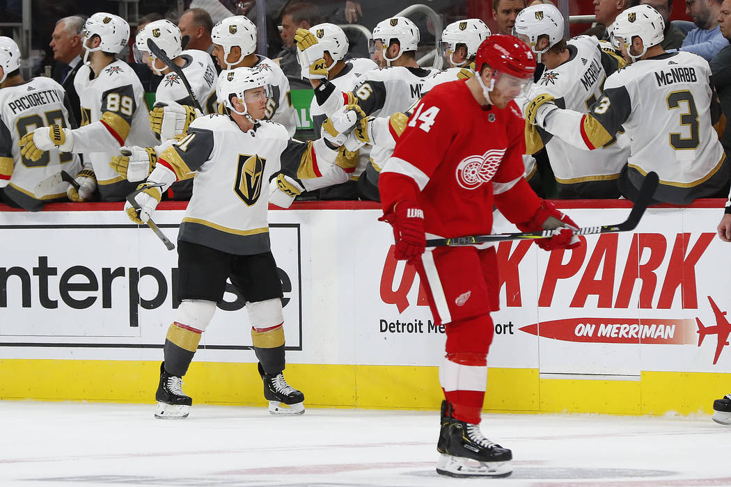 Vegas Golden Knights center Jonathan Marchessault (81) celebrates his goal in the second period of an NHL hockey game as Detroit Red Wings right wing Gustav Nyquist (14) skates to the bench, Thurs ...