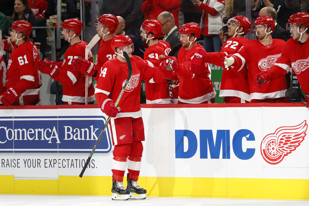 Detroit Red Wings right wing Gustav Nyquist (14) celebrates his goal against the Vegas Golden Knights in the first period of an NHL hockey game Thursday, Feb. 7, 2019, in Detroit. (AP Photo/Paul S ...
