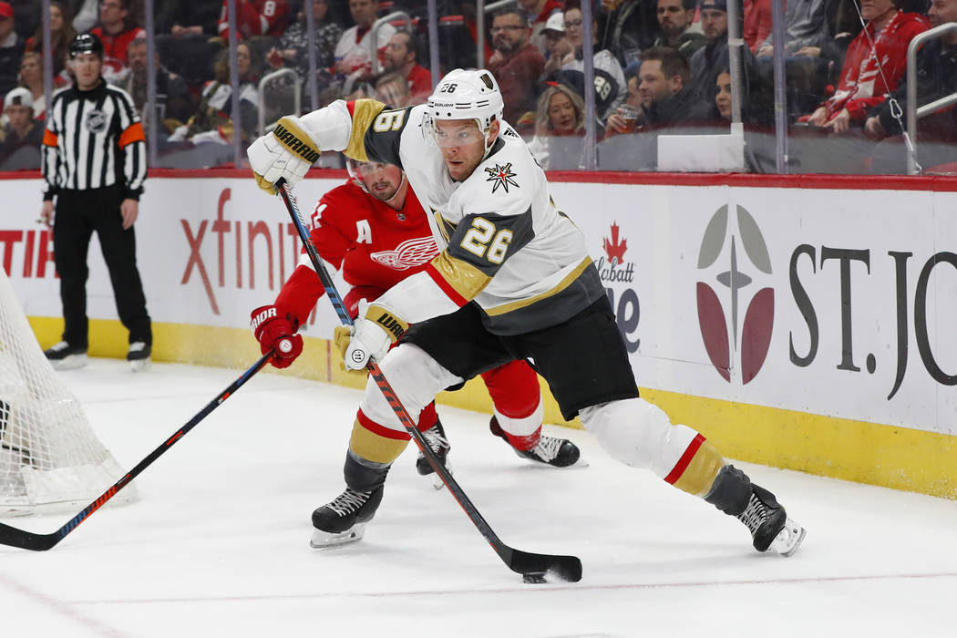 Vegas Golden Knights center Paul Stastny (26) passes from behind the net as Detroit Red Wings center Dylan Larkin (71) watches in the first period of an NHL hockey game Thursday, Feb. 7, 2019, in ...