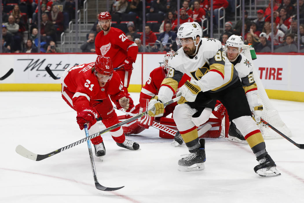 Vegas Golden Knights right wing Alex Tuch (89) passes as Detroit Red Wings center Jacob de la Rose (61) defends in the first period of an NHL hockey game Thursday, Feb. 7, 2019, in Detroit. (AP Ph ...