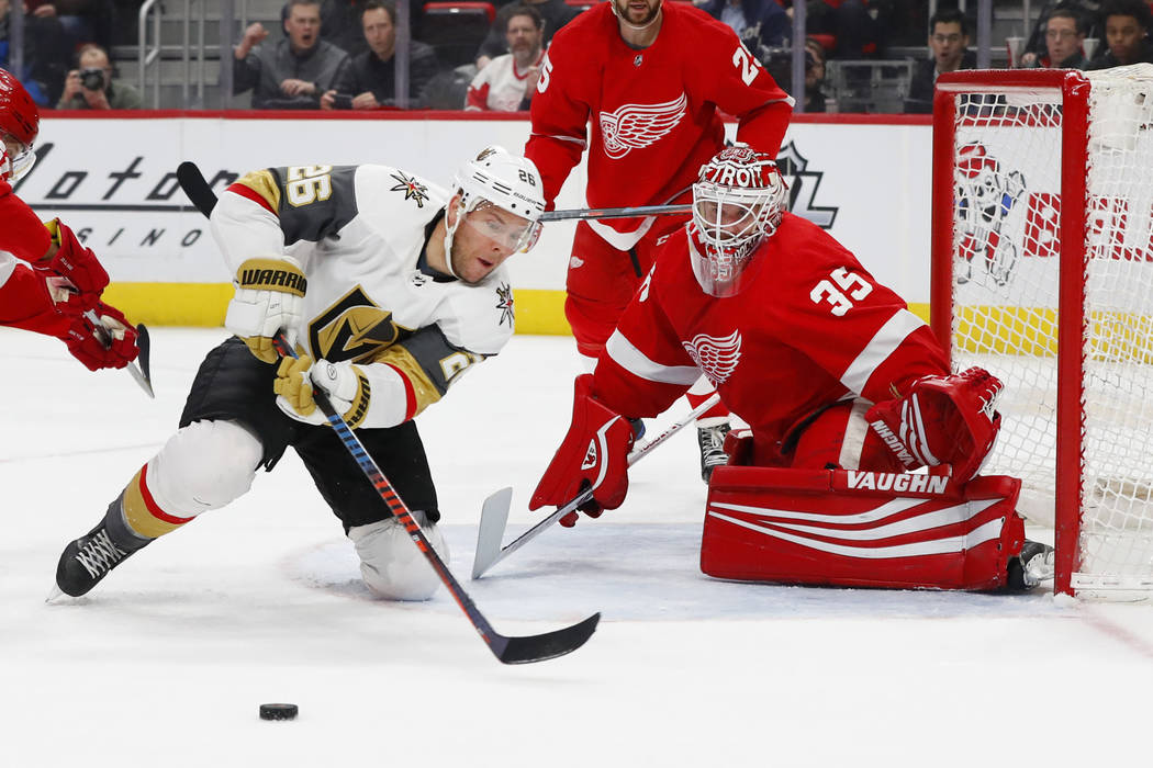 Detroit Red Wings goaltender Jimmy Howard (35) blocks a Vegas Golden Knights center Paul Stastny (26) shot in the first period of an NHL hockey game Thursday, Feb. 7, 2019, in Detroit. (AP Photo/P ...