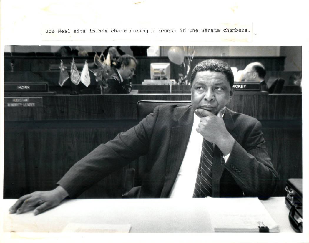 Neal, Joe, Jr. - 1989 Joe Neal sits in his chair during a recess in the Senate chambers. (File Photo/{Las Vegas Review-Journal})