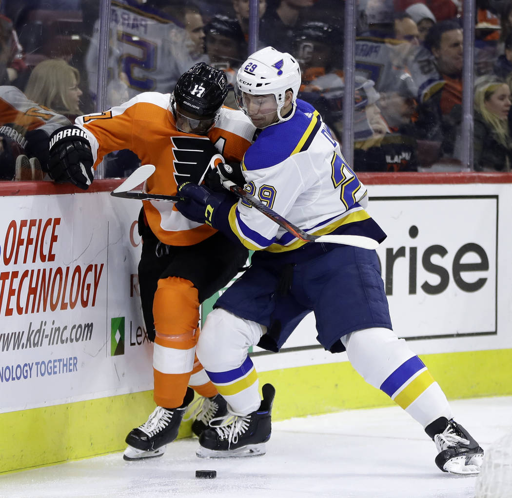 Philadelphia Flyers' Wayne Simmonds, left, is hit by St. Louis Blues' Vince Dunn during the second period of an NHL hockey game, Monday, Jan. 7, 2019, in Philadelphia. (AP Photo/Matt Slocum)