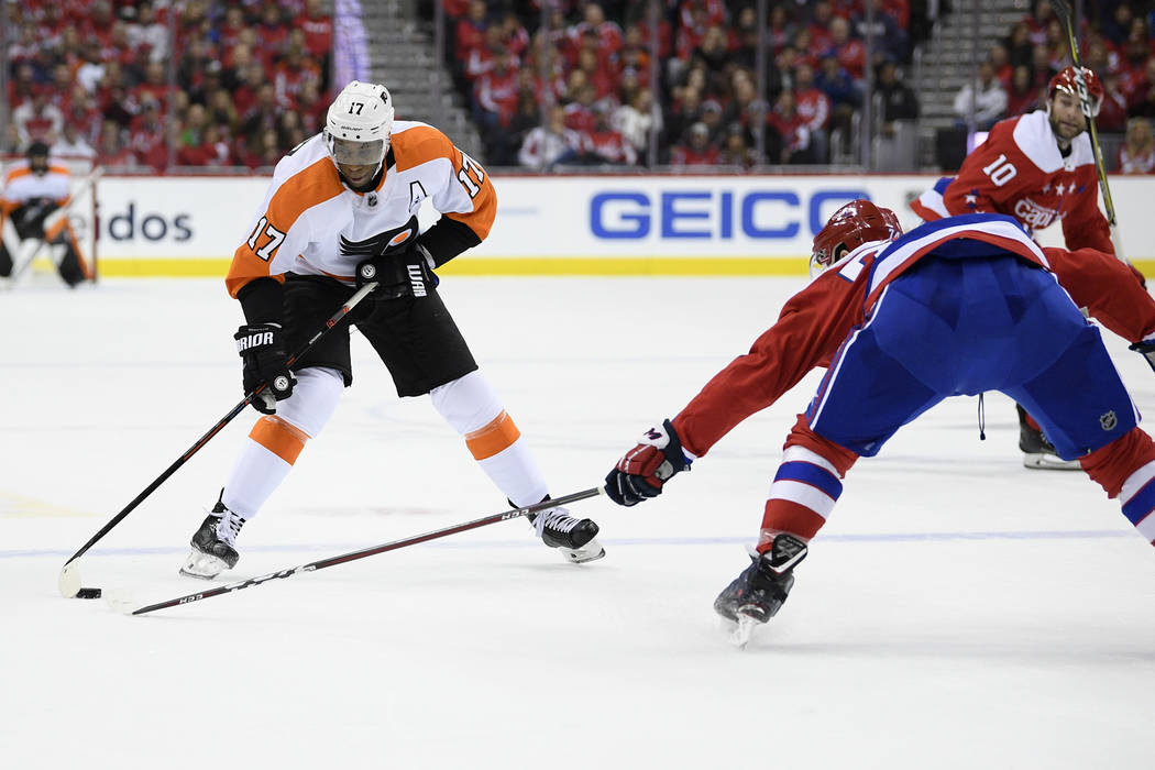 Philadelphia Flyers right wing Wayne Simmonds (17) skates with the puck against Washington Capitals defenseman John Carlson, right, during the first period of an NHL hockey game, Tuesday, Jan. 8, ...