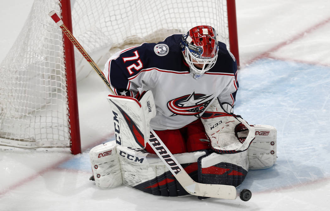 Columbus Blue Jackets goaltender Sergei Bobrovsky makes a stick save against the Colorado Avalanche during the third period of an NHL hockey game Tuesday, Feb. 5, 2019, in Denver. Columbus won 6-3 ...