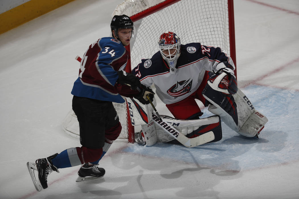 Colorado Avalanche center Carl Soderberg (34) and Columbus Blue Jackets goaltender Sergei Bobrovsky (72) in the third period of an NHL hockey game Tuesday, Feb. 5, 2019, in Denver. Columbus won 6- ...