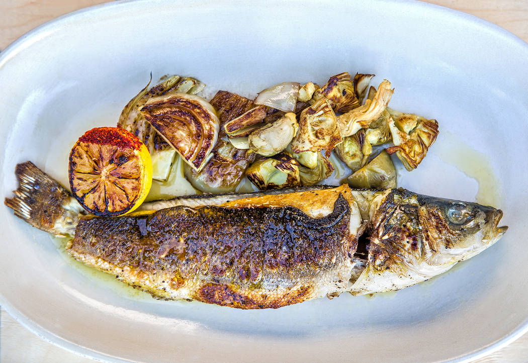 Branzino with grilled sea bass, fennel and artichokes at Eataly on Wednesday, Feb. 6, 2019, at Park MGM, in Las Vegas. (Benjamin Hager/Las Vegas Review-Journal) @BenjaminHphoto