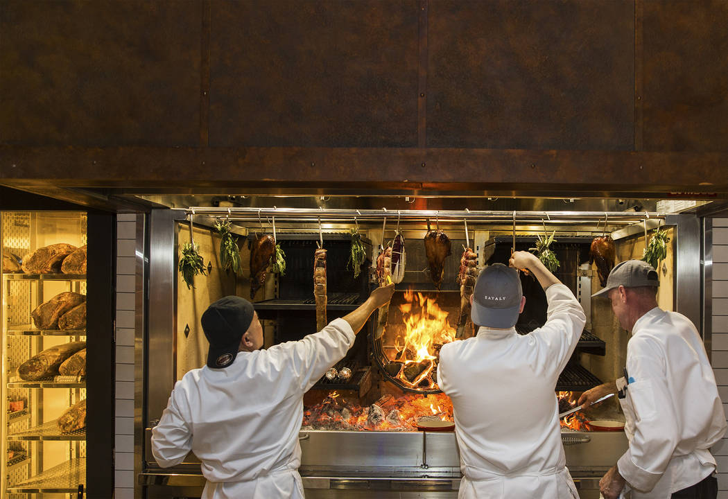 Master cooks Reuben Alejo, left, Patrick Barberis and Scott Brown cook on the open-hearth fire at Eataly on Wednesday, Feb. 6, 2019, at Park MGM, in Las Vegas. (Benjamin Hager/Las Vegas Review-Jou ...