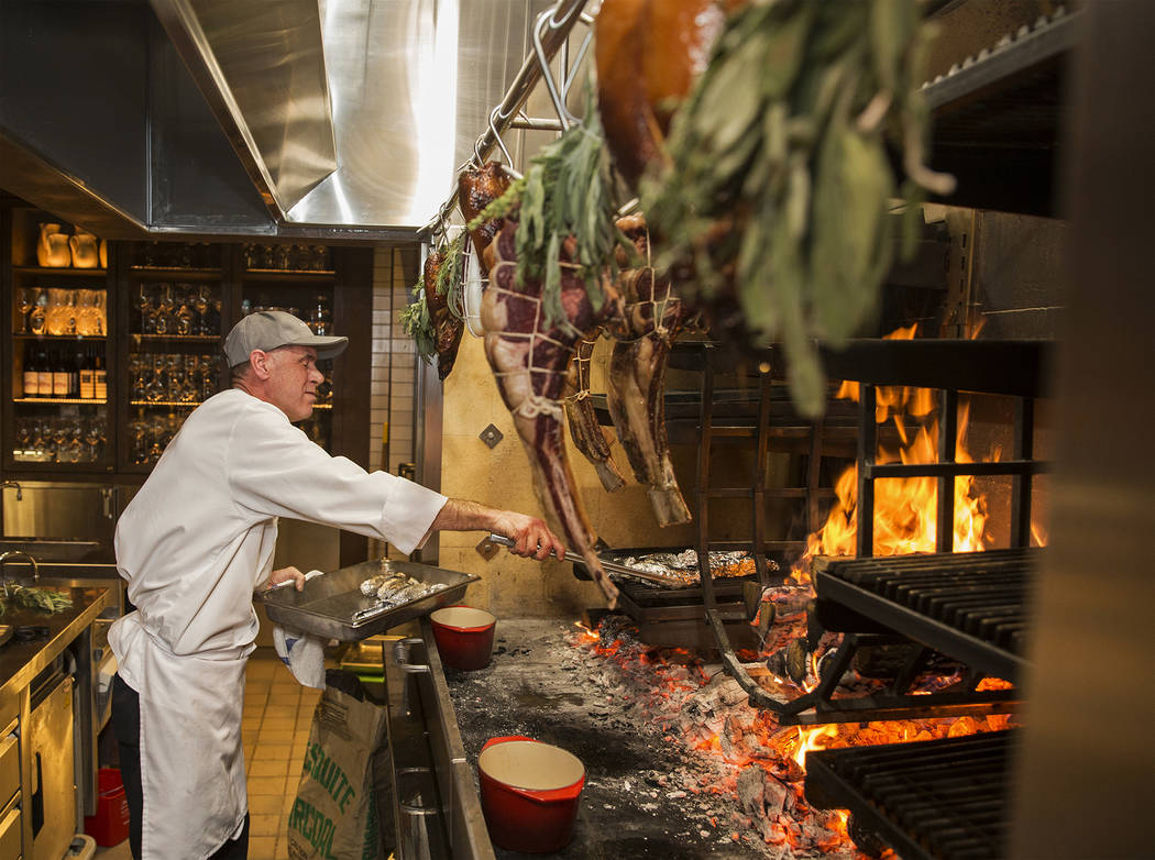Master cook Scott Brown cooks on the open-hearth fire at Eataly on Wednesday, Feb. 6, 2019, at Park MGM, in Las Vegas. (Benjamin Hager/Las Vegas Review-Journal) @BenjaminHphoto