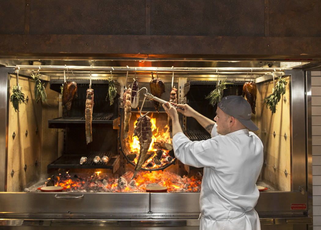 Master cook Scott Barberis cooks on the open-hearth fire at Eataly on Wednesday, Feb. 6, 2019, at Park MGM, in Las Vegas. (Benjamin Hager/Las Vegas Review-Journal) @BenjaminHphoto