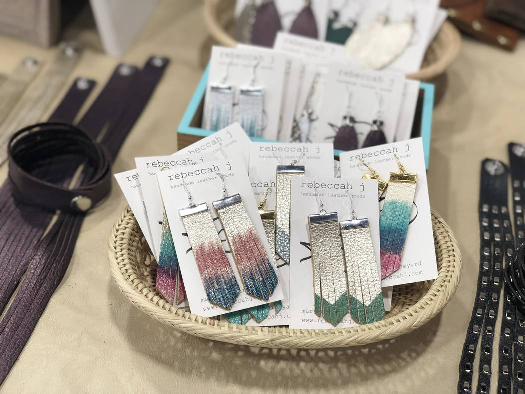 Hand-painted leather cascade earrings by Rebeccah J. (Janna Karel Las Vegas Review-Journal)