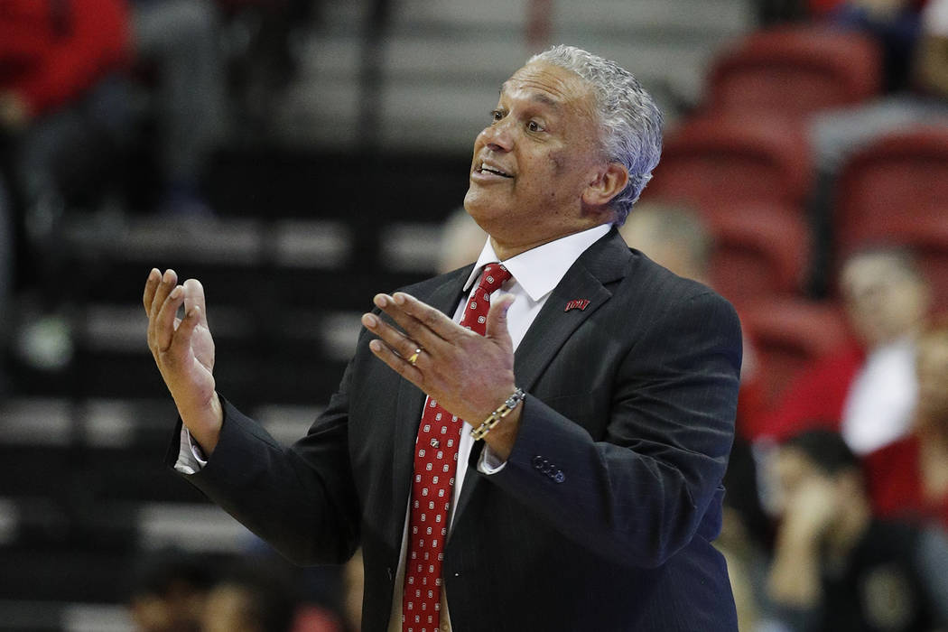 UNLV head coach Marvin Menzies coaches against Nevada during the second half of an NCAA college basketball game Tuesday, Jan. 29, 2019, in Las Vegas. Nevada won 87-70. (AP Photo/John Locher)