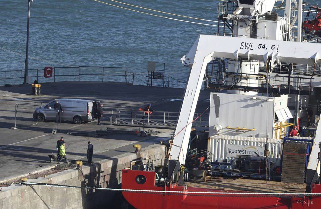 A van stands by the Geo Ocean III specialist search vessel docked in Portland, England, which is carrying a body recovered from the wreckage of the plane carrying Cardiff City footballer Emiliano ...