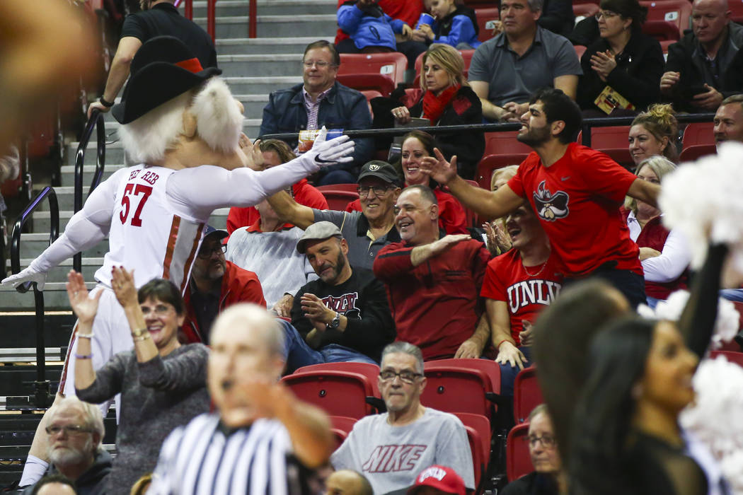 UNLV Rebels mascot Hey Reb! celebrates with fans during the second half of a basketball game against Wyoming at the Thomas & Mack Center in Las Vegas on Saturday, Jan. 5, 2019. Chase Stevens L ...