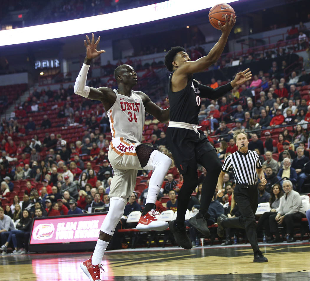 San Diego State Aztecs guard Devin Watson (0) goes to the basket past UNLV Rebels forward Cheikh Mbacke Diong (34) during the first half of a basketball game at the Thomas & Mack Center in Las ...