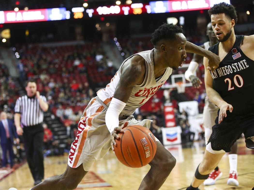 UNLV Rebels guard Kris Clyburn (1) moves the ball around San Diego State Aztecs guard Jordan Schakel (20) during the second half of a basketball game at the Thomas & Mack Center in Las Vegas o ...